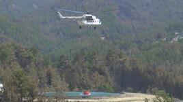 3 dakikada 8 helikopter su alıyor