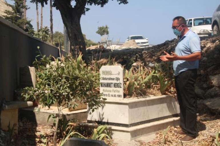 4 mezar, mezarlığın dışında kalınca, yapılan duvar geri yıkıldı .